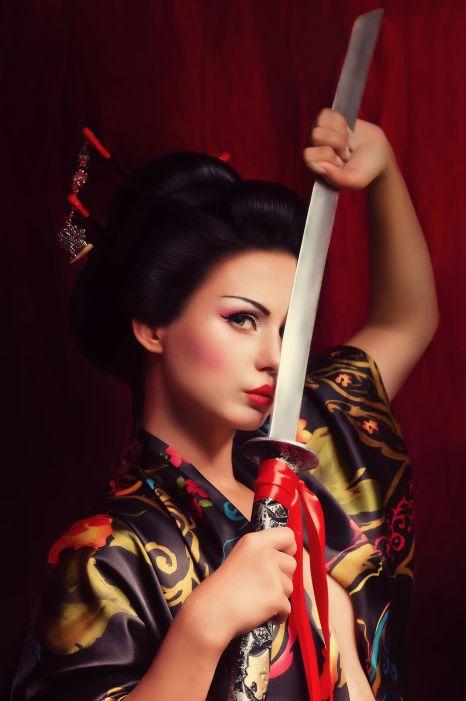 25613165 - beautiful geisha in kimono with samurai sword