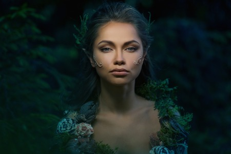 43589229 - elf woman in a magical forest