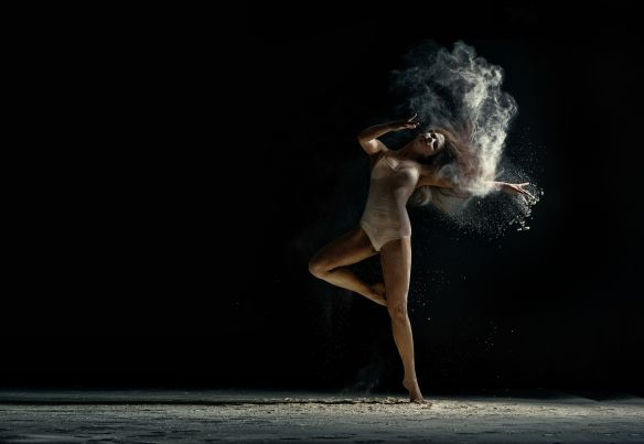 60177670 - amazing photo of graceful woman dancing with dust in studio